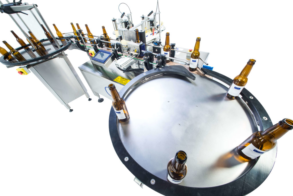 Ninon range, CDA's automatic bottle labeling machine