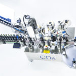 R1000, CDA's automatic bottle labeling machine