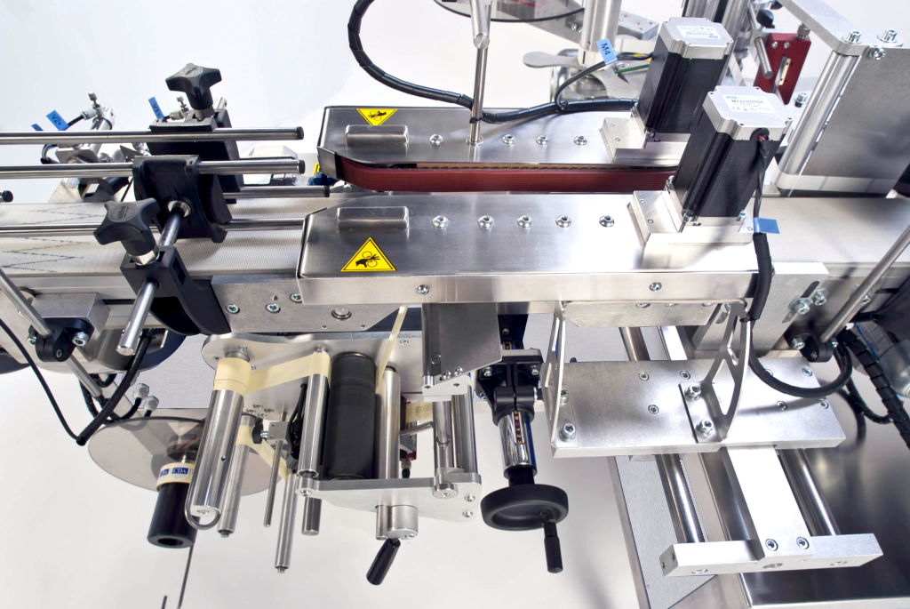 Ninon Down, CDA's automatic bottle labeling machine