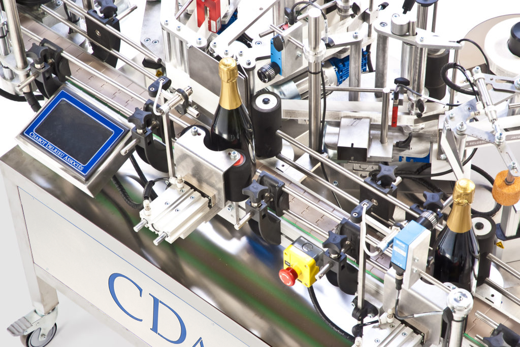 R1000 Foils, CDA's automatic champagne bottle labeling machine