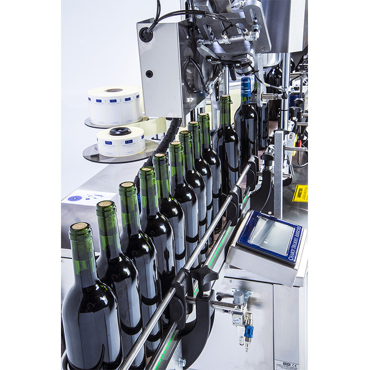automatic labeling system for cda usa spirits bottles